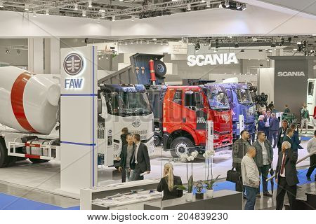 MOSCOW, SEP, 5, 2017: Close up view on Chinese FAW trucks exhibit on Commercial Transport Exhibition ComTrans-2017. FAW commercial transport on exhibition stand. Commercial trucks Chinese cars