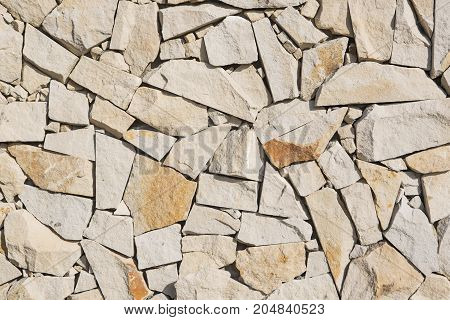 Wall made of natural beige and brown stones
