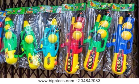 Hat Yai Songkhla: April 11 2017: Midnight Songkran Festival in Hat Yai Songkhla Thailand Have colorful water guns for sales at this event.