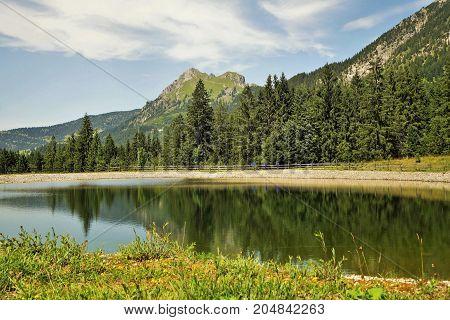 Mount Aggenstein in Tyrol Austria with storage pond