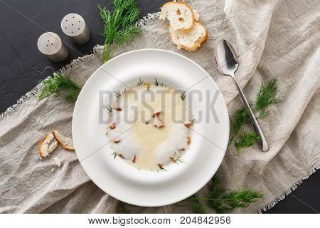 Delicious cream soup with honey fungus top view. Gourmet meal with mushrooms and crusty bread, restaurant serving