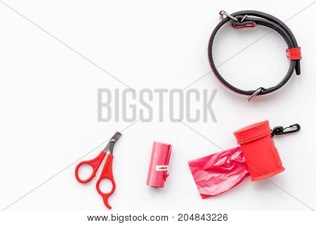 pet care and red grooming tools on white table background top view space for text
