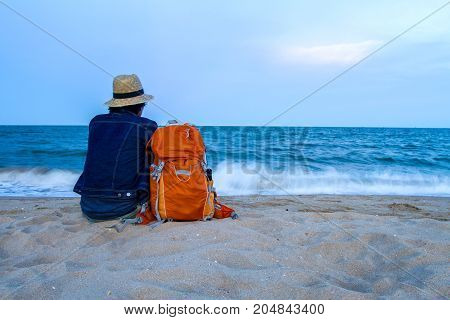 traveler with backpack and vacation with sunset over the tropical beach and sea a beautiful in thailand
