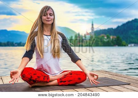 Woman Doing Yoga By The Lake, Toned Image, Color Image