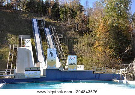 LAKE PLACID, NY, USA - OCT. 3, 2010: Freestyle skiing training in Lake Placid US Olympic Training Site, New York State, USA.
