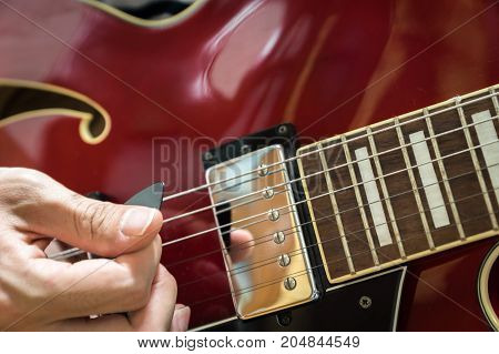 electric guitar close-up playing for jazz rock music