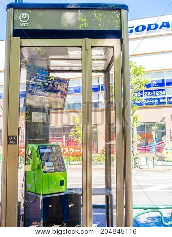 KYOTO, JAPAN - JULY 05, 2017: Public phone in Osaka, Japan. Blurry phone through the glass in Kyoto