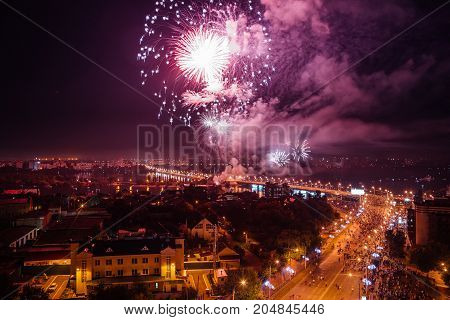 Salute above Voronezh during celebration of festival the Day of the City, aerial view from rooftop