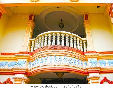 Singapure - December 24, 2008: A colorful balcony at the Residence of Tan Teng Niah, the last remaining Chinese villa and a brightly colored landmark in Little India, Singapore on December 24, 2008