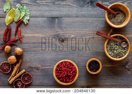 Spicy food cooking with spices and dry herbs on wooden kitchen desk background top view mockup