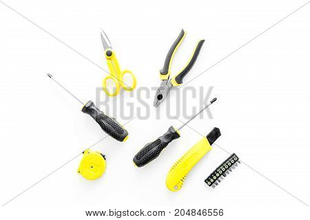 constructor desk with set of building implements on white desk background top view