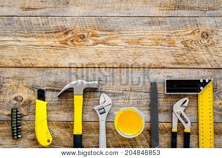 set of tools for build and repair house on wooden desk background top view frame mock-up