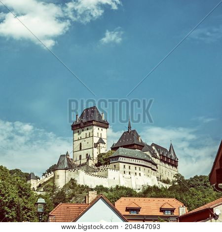 Gothic castle Karlstejn in Czech republic. Ancient architecture. Travel destination. Old photo filter.