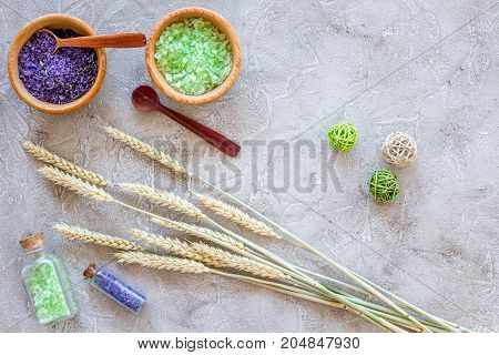 natural cosmetics with wheat and herbs for homemade spa on stone table background top view