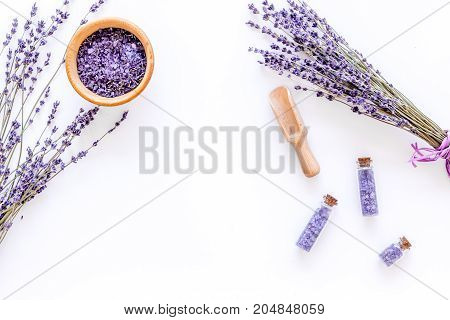 bath salt in herbal cosmetic set with lavender on white desk background top view space for text