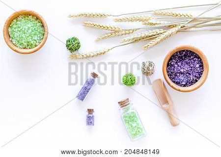 home made spa with wheat herbs cosmetic salt for bath on white desk background top view