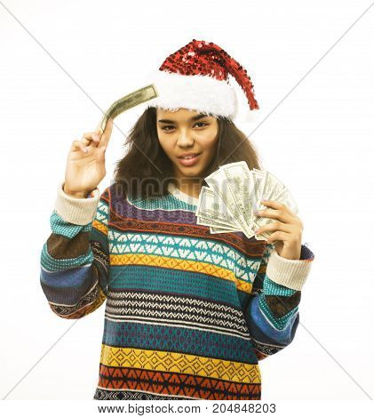 cute young real african real hipster girl in santas red hat isolated on white background waiting for winter Christmass