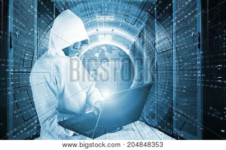 concept of a hacker attack with the hooded man with laptop in data center among supercomputers
