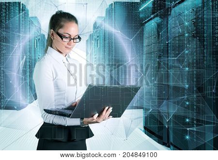 young business lady in glasses with a laptop in hand on background of holograms and supercomputers data center.