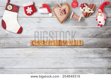 Christmas Greeting Card with Xmas Elements on Gray Wooden Background. Retro Style. Space for Text.