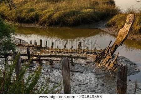 abandoned old fishing boat lying near the mud in comporta alentejo Portugal.