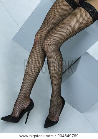 Black pantyhose in a grid and sexy high heels