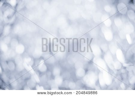 Sparkling Abstract Circles Bokeh Background with defocused lights. Festive xmas abstract background with bokeh defocused lights and boke.