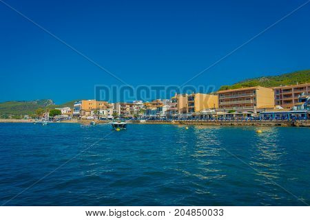 PORT D ANDRATX, SPAIN - AUGUST 18 2017: Beautiful view of Mallorca balearic islands, with some buildings in the horizon, with gorgeous blue water and a beautiful blue sky, in Spain.