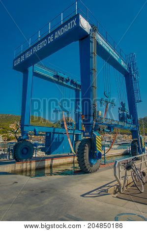 PORT D ANDRATX, SPAIN - AUGUST 18 2017: Close up of a blue machine for transport yatchs from land to water, at Port d Andratrx, Spain.