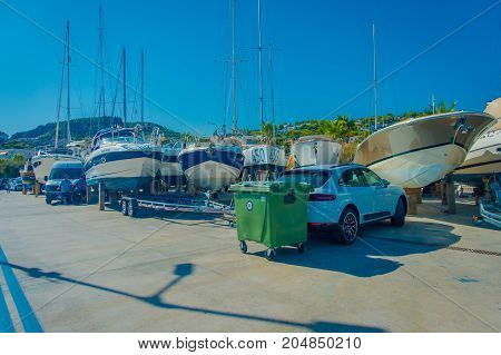 PORT D ANDRATX, SPAIN - AUGUST 18 2017: Car parked with some yatch around, in Port d Andratrx, Spain.