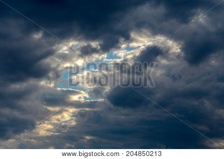 Cloudscape, background sky with reflected rays of the sun in clouds