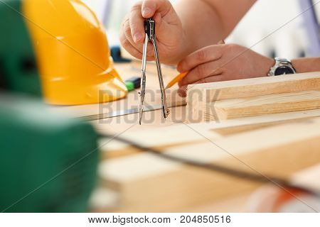 Arms Of Worker Making Structure Plan On Scaled Paper