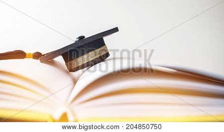 Graduation cap on Books step in Library room of campus and university Concept of abroad international Educational Back to School