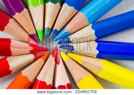 Color pencils in round formation on white background. Shot at extreme close-up