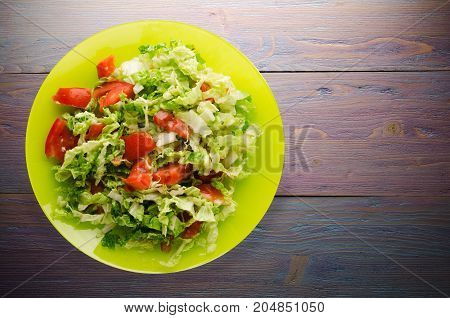 Salad Of Cabbage Tomato On A Plate On A Wooden Background