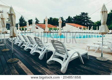 Colorful Wooden Beach Chairs With Sun Umbrella