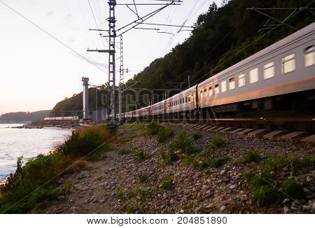 Sochi Russia - July 02, 2014: Evening train from Sochi is riding along the Black Sea coast