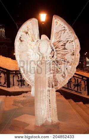 Russia Izhevsk - January 29 2017:Ice angel is standing near the Svyato Mikhaylovsky sobor. Christmas holidays.