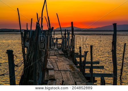 Sunset in Carrasqueira ancient fishing port in comporta alentejo Portugal.