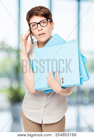 Accountant With Folders And Phone In The Office Portrait