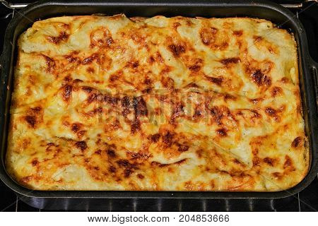 home cooked lasagna on a baking sheet