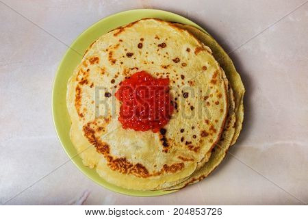 the homemade pancakes on a plate with red caviar