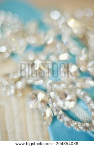 Background, texture, embroidered lace. Delicate detail of a wedding dress. soft focus