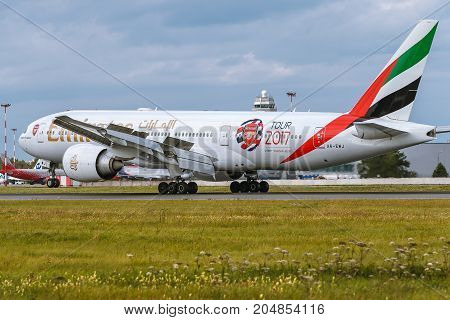 Pulkovo Saint-Petersburg Russia - August 10 2017: Boeing 777 of Emirates airlines is landing. Has a special painte of Arsenal club