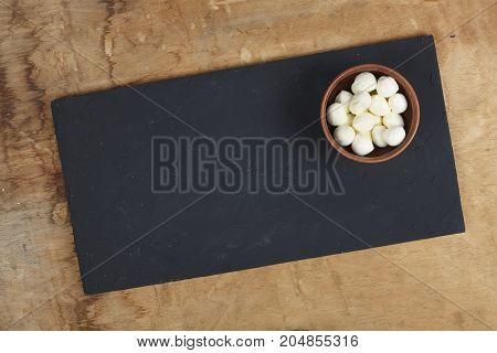 Mozzarella In A Bowl On A Stone Table