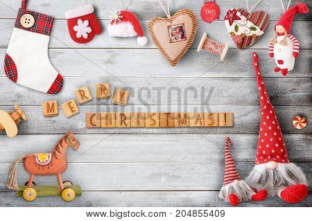 Christmas Greeting Card with Xmas Elements wooden cubes and Toys on Gray Wooden Background. Retro Style.