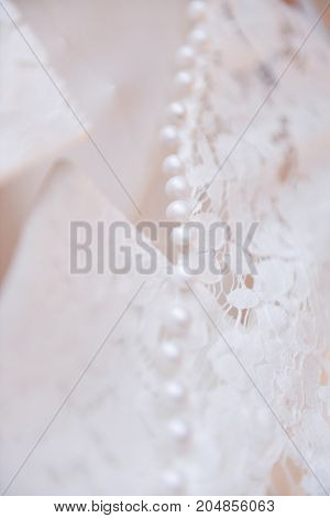 Background, texture, embroidered lace. Delicate detail of a wedding dress. Fine lace