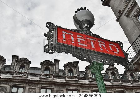 HDR view of the Paris Metro sign.