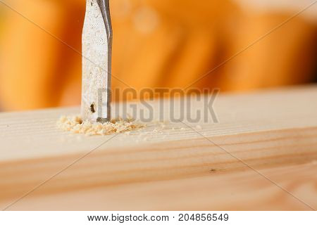 Flat Drill Bit Make Hole In Wooden Bar Closeup