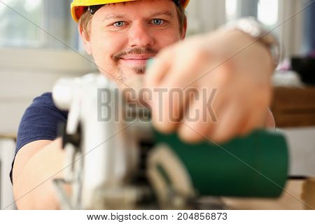 Worker Using Electric Saw Portrait